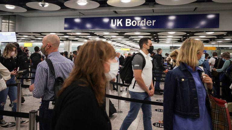 Arriving passengers queue at UK Border Control at the Terminal 5 at Heathrow Airport