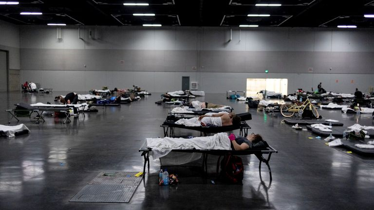 FILE PHOTO: People sleep at a cooling shelter set up during an unprecedented heat wave in Portland, Oregon, June 27. REUTERS/Maranie Staab/File Photo