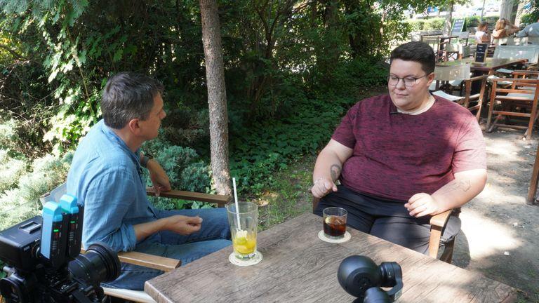 Hungarian transgender activist Emmett Hegedus speaking to Adam Parsons