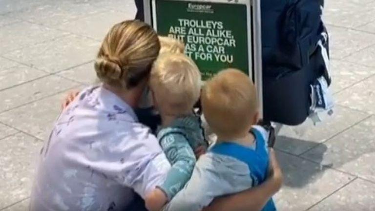 Olympian Helen Glover greets hr three children at airport