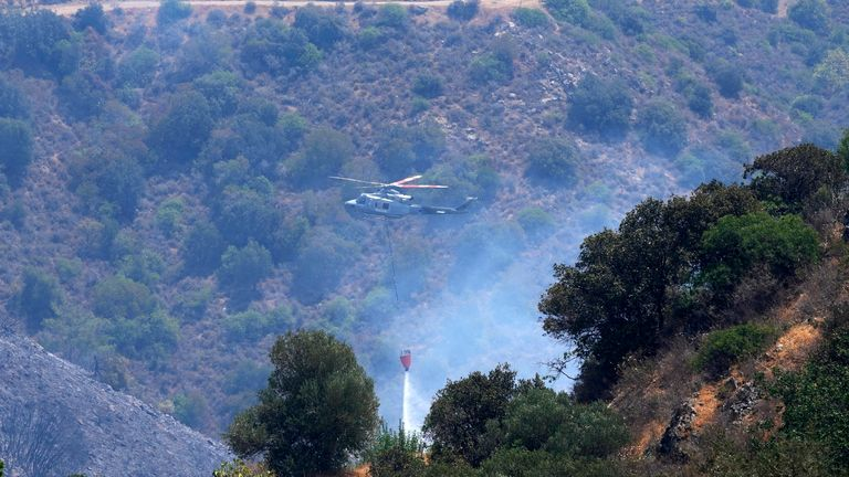 Helicopters have been dropping water on the fire