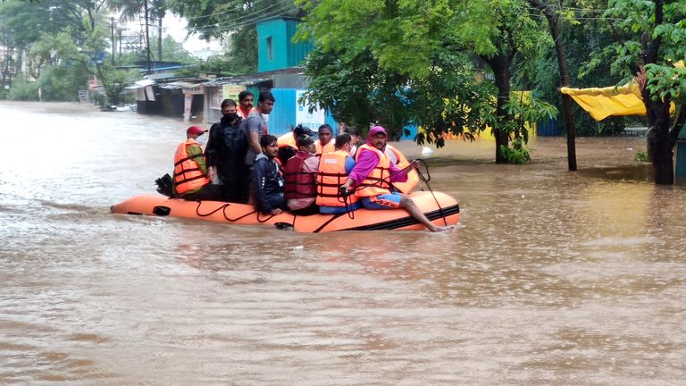 National Disaster Response Force personnel rescue people stranded in floodwaters in Kolhapur, in the western Indian state of Maharashtra, Friday, July 23, 2021. Landslides triggered by heavy monsoon rains hit parts of western India, killing more than 30 people and leading to the overnight rescue of more than 1,000 other people trapped by floodwaters, officials said Friday. (AP Photo)
