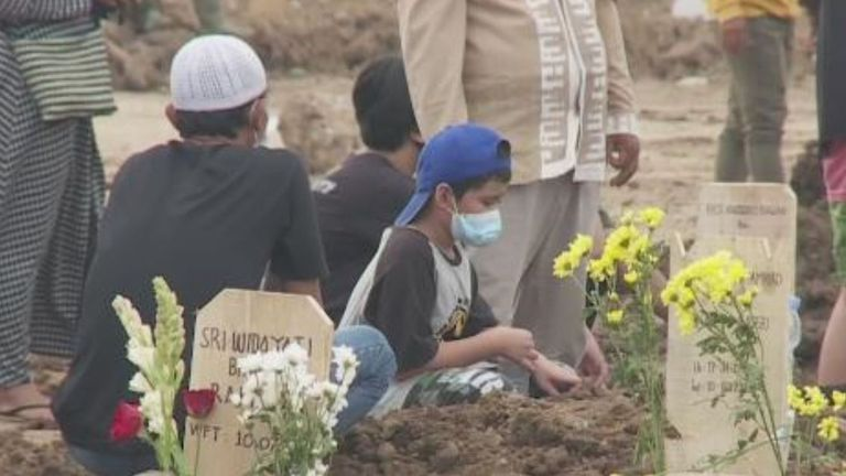 Families at loved ones' graves