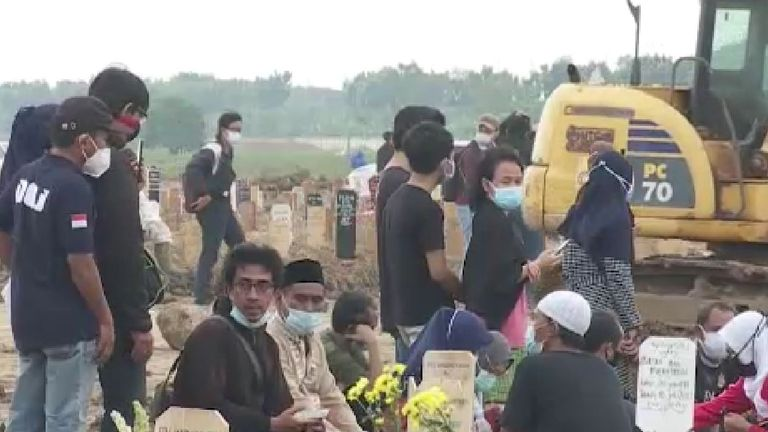 Even as families mourn lost loved ones, new graves are being dug a few feet away