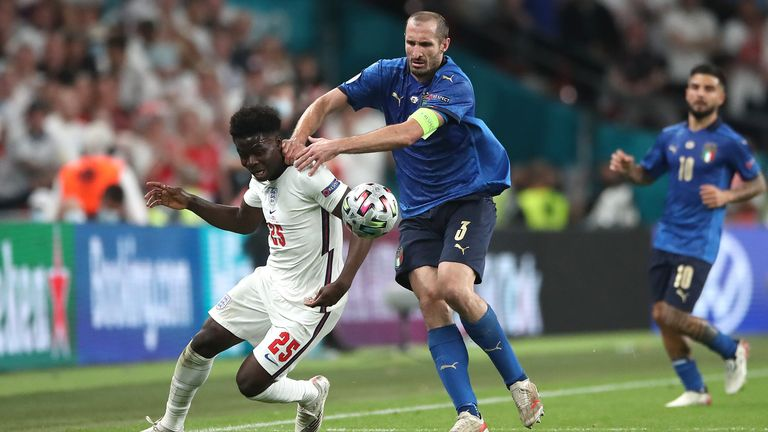 Italy's Giorgio Chiellini got a yellow card for hauling Bukayo Saka back just before full-time