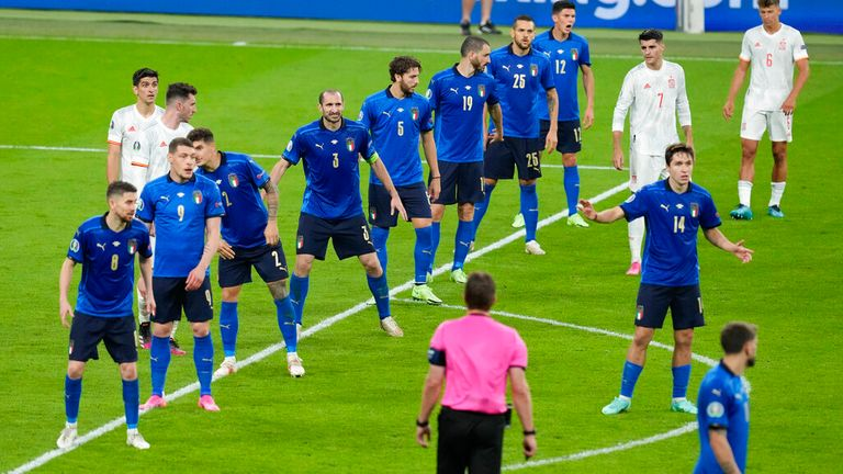 Italy prepare for a Spanish free kick during their semi-final at Wembley. Pic: AP