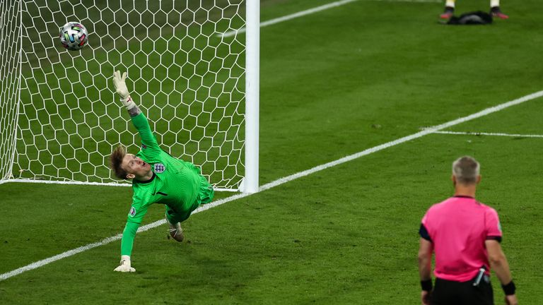 England goalkeeper Jordan Pickford concedes in the penalty shootout