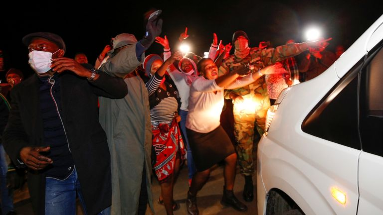 Supporters of former South African President Jacob Zuma rally outside his home in Nkandla, South Africa, July 7, 2021