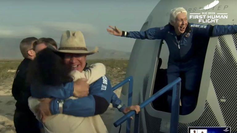 Wally Funk celebrates as Mr Bezos hugs his parents. Pic: Blue Origin