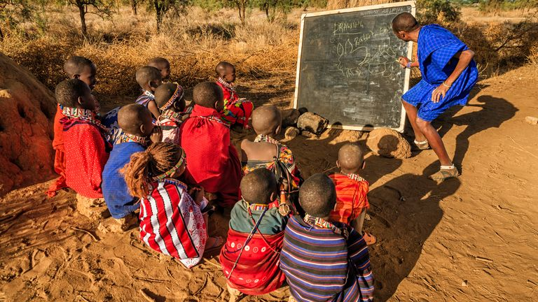 African children from Maasai tribe during classes under the acacia tree in remote village, Kenya, East Africa. Maasai tribe inhabiting southern Kenya and northern Tanzania, and they are related to the Samburu.