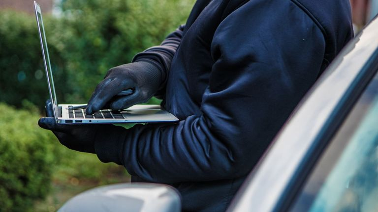 Relay technology is used to receive the signal from a key inside a house. That signal is then transferred to a portable device, allowing them to unlock and drive the car