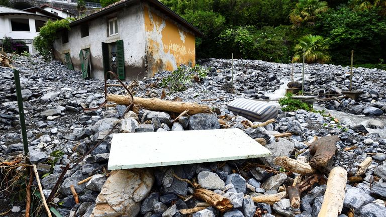 A house hit by a landslide is seen after heavy rain