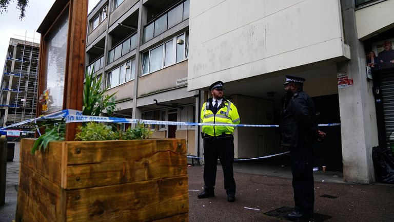 Police at the scene in Oval Place, Lambeth, south London, where a 16-year-old boy died after being stabbed on Monday evening. Picture date: Tuesday July 6, 2021.
