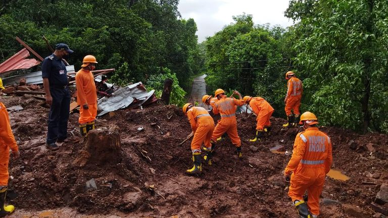 Members of National Disaster Response Force (NDRF) conduct a search and rescue operation after a landslide following heavy rains in Ratnagiri district, Maharashtra state, India, July 25, 2021. National Disaster Response Force/Handout via REUTERS ATTENTION EDITORS - THIS IMAGE WAS PROVIDED BY A THIRD PARTY. NO RESALES. NO ARCHIVES.