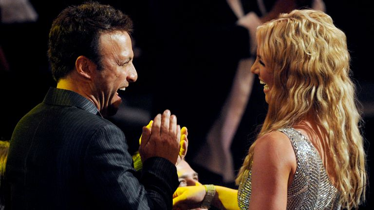 Britney Spears and her manager, Larry Rudolph react after she wins one of three awards at the 2008 MTV Video Music Awards held at Paramount Pictures Studio Lot on Sunday, Sept. 7, 2008, in Los Angeles. (AP Photo/Kevork Djansezian)