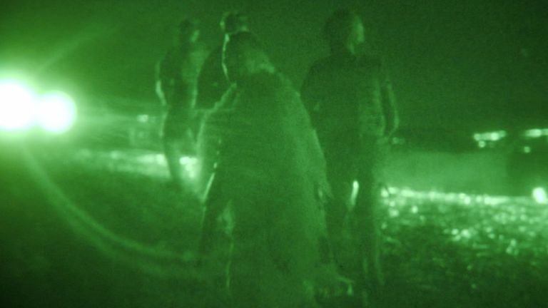 With the night vision goggles on, 'a green-tunnelled world opened around me'