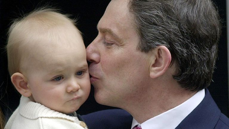 British Prime Minister Tony Blair kisses his youngest son Leo outside his official residence at 10 Downing Street, London, after winning the General Election and securing a historic second Labour landslide victory.