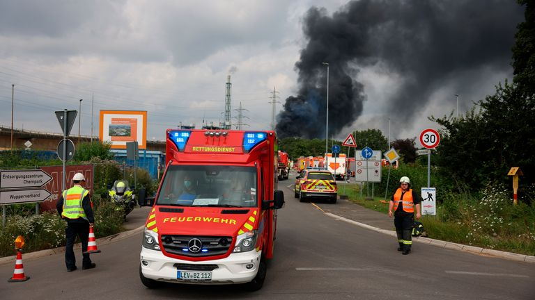 27 July 2021, North Rhine-Westphalia, Leverkusen: A dark cloud of smoke rises above the Chempark. After an explosion, fire brigade, rescue forces and police are currently in large-scale operation, the police explained. Due to the damage, the busy motorway A1 near Leverkusen has been closed. Photo by: Oliver Berg/picture-alliance/dpa/AP Images