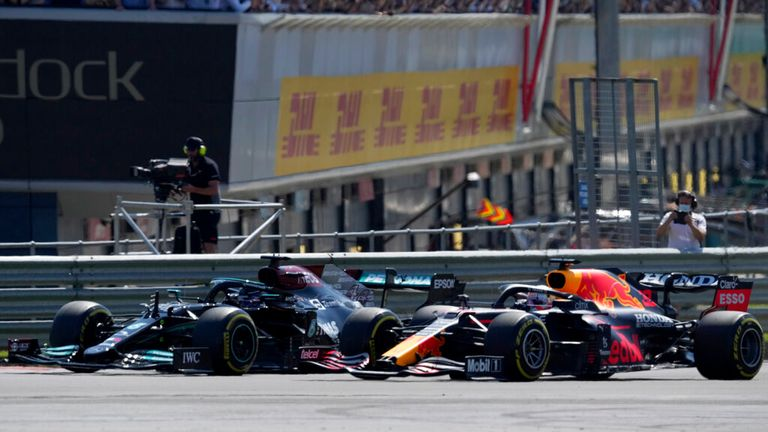 Lewis Hamilton (L) and Red Bull driver Max Verstappen at the start of the Grand Prix