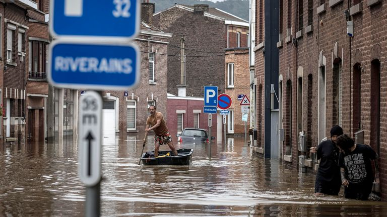 A man paddles down a street in Liege. Pic: Associated Press