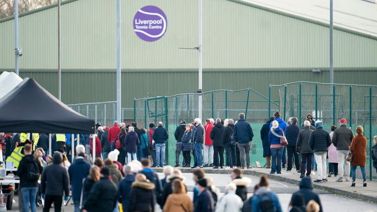 Members of the public queue at Wavertree Sports Park in Liverpool on 6 November 2020