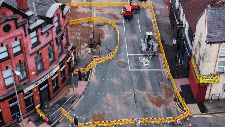 The cordon next to a 4.5 metre (15ft) by six metre (20ft) sinkhole in Green Lane, Old Swan, Liverpool, caused by a suspected ruptured water main. Picture date: Saturday July 24, 2021.