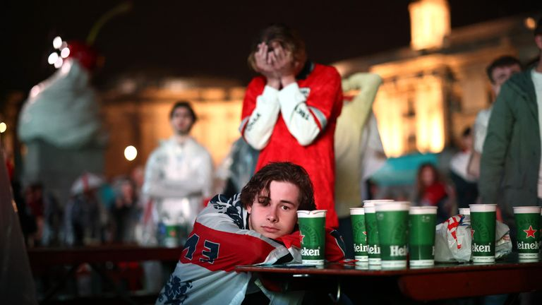 THIS IS FOR SHARON'S PIC PIECE Soccer Football - Euro 2020 - Final - Fans gather for Italy v England - London, Britain - July 11, 2021 England fans react while watching the penalty shooter during the match at Trafalgar Square REUTERS/Henry Nicholls