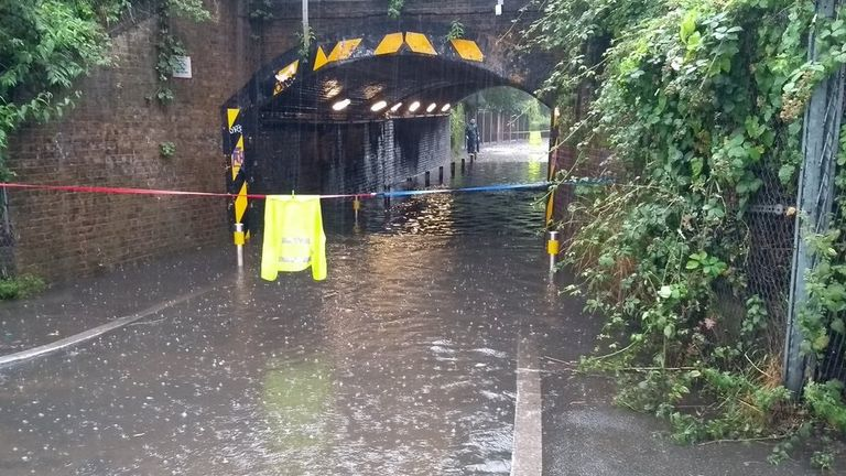 A flooded road in south London. Pic: @DanHolden85