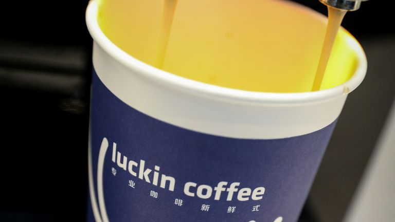 A cup of coffee is poured during Luckin Coffee's IPO at the Nasdaq Market site in New York, U.S., May 17, 2019.