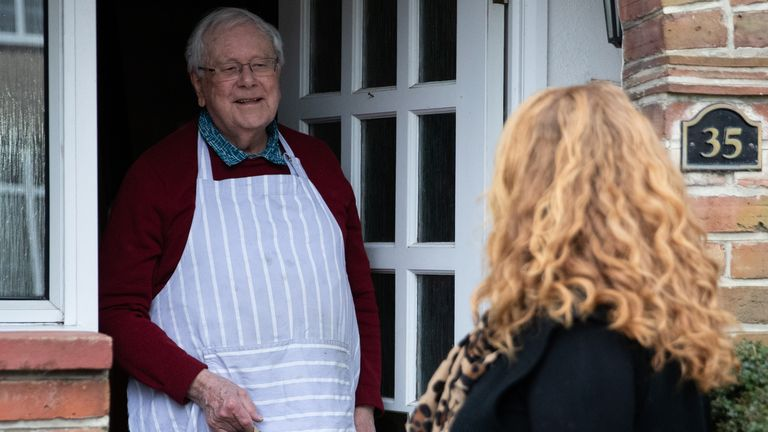 A volunteer makes a delivery of hot food for the Chichester Cathedral Friday lunch club