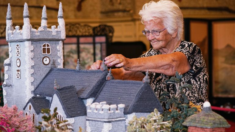Margaret Seaman, 92, makes adjustments to her 18ft-long 'Knitted Sandringham'
