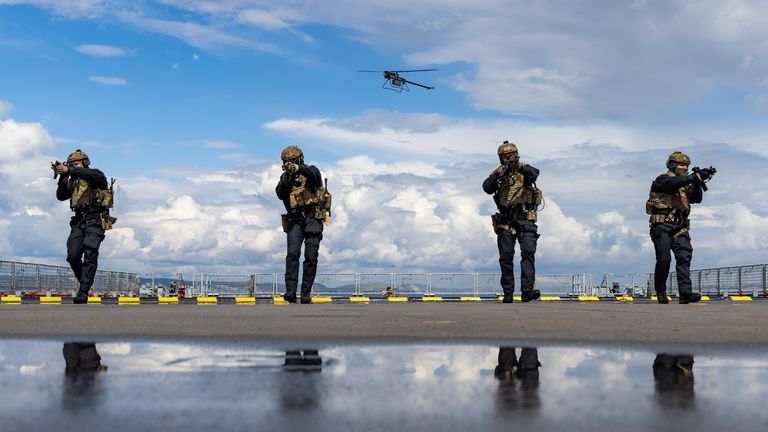 Ministry of Defence undated handout photo of ranks from 42 Commando Royal Marine's Fleet Contingency Troop, conducting high vertical assault drills onto RFA Mounts Bay in Portland Harbour, supported by a Ghost drone.