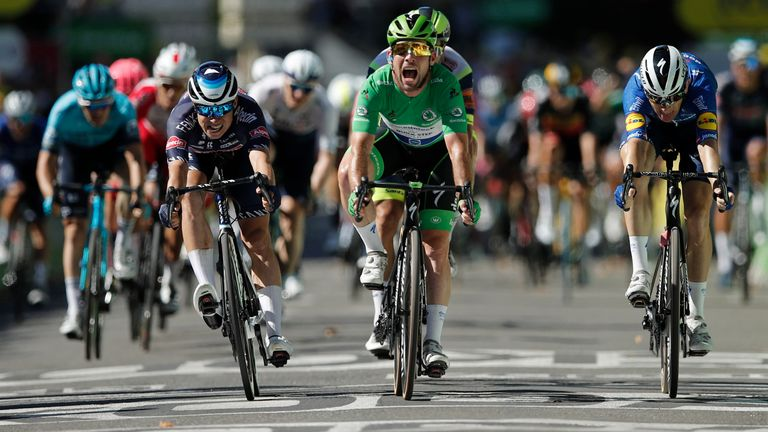 Cycling - Tour de France - Stage 13 - Nimes to Carcassonne - France - July 9, 2021 Deceuninck–Quick-Step rider Mark Cavendish of Britain wearing the green jersey celebrates as he crosses the line to win stage 13 REUTERS/Benoit Tessier