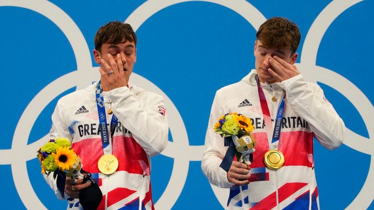 Thomas Daley and Matty Lee of Britain react after winning gold medals during the men's synchronized 10m platform diving final at the Tokyo Aquatics Centre at the 2020 Summer Olympics, Monday, July 26, 2021, in Tokyo, Japan. (AP Photo/Dmitri Lovetsky)
