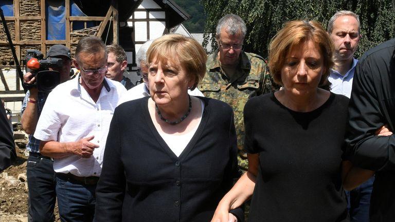German Chancellor Angela Merkel and Rhineland-Palatinate State Premier Malu Dreyer walk through the flood-ravaged village of Schuld near Bad Neuenahr-Ahrweiler, Rhineland-Palatinate state, Germany, July 18, 2021. Christof Stache/Pool via REUTERS