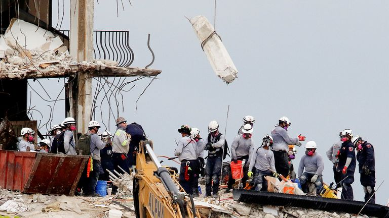 Emergency workers conduct search and rescue efforts at the site of a partially collapsed residential building in Surfside, near Miami Beach, Florida