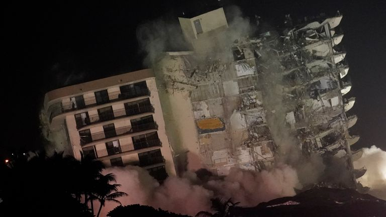 The damaged remaining structure at the Champlain Towers South condo building collapses in a controlled demolition. Pic AP