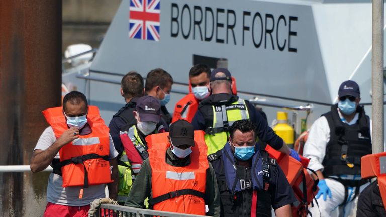 A group of people thought to be migrants are brought in to Dover, Kent, onboard a border force boat following a small boat incident in the Channel. Picture date: Wednesday July 21, 2021.