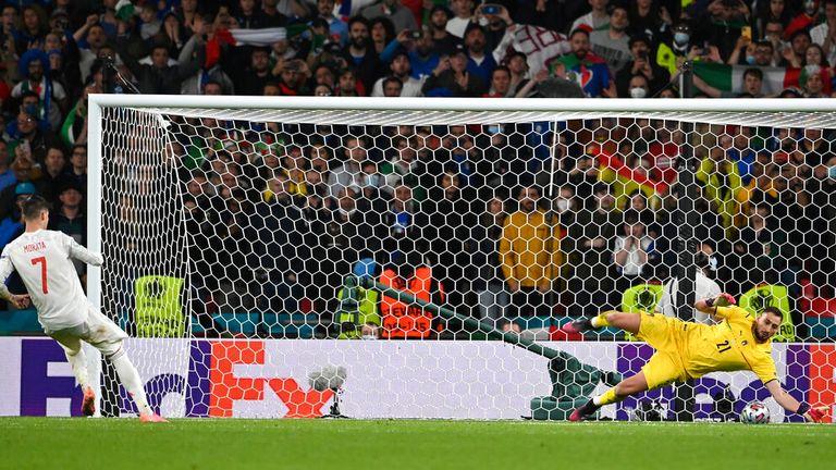 Gianluigi Donnarumma got a hand to Morata's penalty