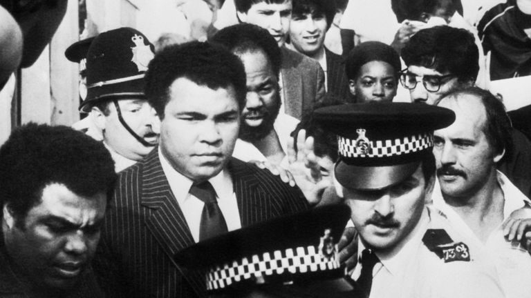 PAP 206436-1  August 9th 1983.SCUFFLE AS ALI OPENS COMMUNITY CENTRE.A police escort for former world heavyweight champion Muhammad Ali when he opened the community centre in Birmingham named after him after a free-for-all broke out at the centre entrance..PAP 206436-1  August 9th 1983