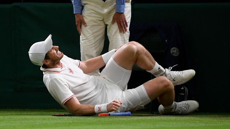 Tennis - Wimbledon - All England Lawn Tennis and Croquet Club, London, Britain - June 30, 2021 Britain's Andy Murray falls during his second round match against Germany's Oscar Otte REUTERS/Toby Melville
