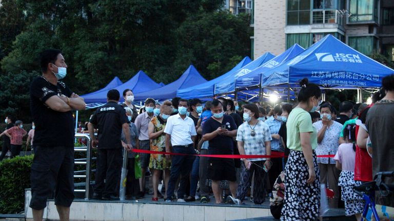 Residents queue up for a COVID test in a housing block in Nanjing