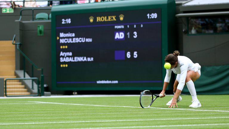 Monica Niculescu slips during her singles match against Aryna Sabalenka on court one on day one of Wimbledon at The All England Lawn Tennis and Croquet Club, Wimbledon. Picture date: Monday June 28, 2021.