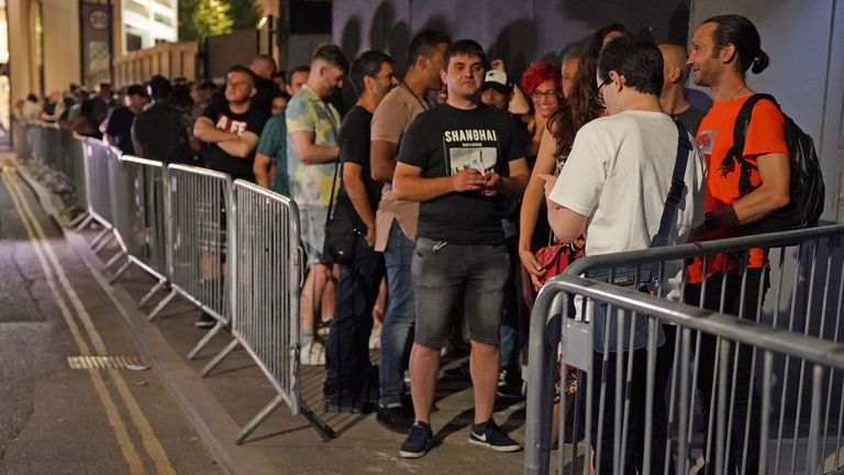 People queue to enter Egg nightclub in London at midnight on 19 July