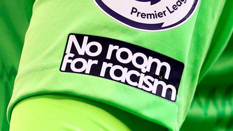 No Room For Racism logo on the shirt of Everton's goalkeeper Jordan Pickford during the English Premier League soccer match between Tottenham Hotspur and Everton at the Tottenham Hotspur Stadium in London, Sunday, Sept. 13, 2020. (Cath Ivill/Pool via AP)