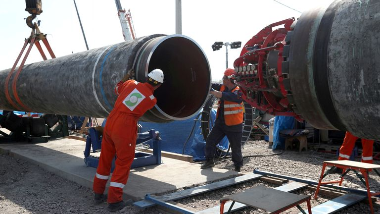 Workers are seen at the construction site of the Nord Stream 2 gas pipeline, near the town of Kingisepp, Leningrad region, Russia