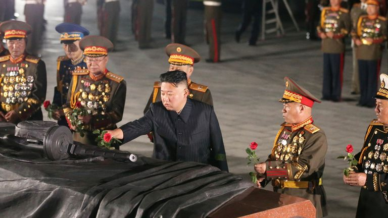 North Korean leader Kim Jong Un lays a flower at the Fatherland Liberation War Martyrs Cemetery for the 68th anniversary of the Korean armistice, in Pyongyang, North Korea, in this photo supplied by North Korea's Korean Central News Agency (KCNA) on July 27, 2021. KCNA via REUTERS ATTENTION EDITORS - THIS IMAGE WAS PROVIDED BY A THIRD PARTY. REUTERS IS UNABLE TO INDEPENDENTLY VERIFY THIS IMAGE. NO THIRD PARTY SALES. SOUTH KOREA OUT.