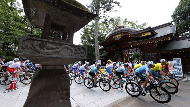 Tokyo 2020 Olympics - Cycling - Road - Men's Road Race - Final - Tokyo to Fuji International Speedway, Japan - July 24, 2021. Riders pass the Okunitama shrine REUTERS/Christian Hartmann