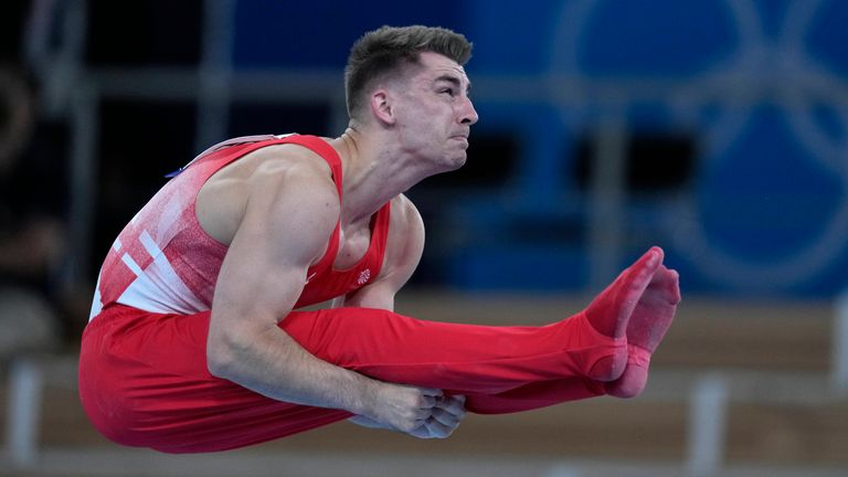 Max Whitlock, of Britain, performs on the horizontal bar during the men's artistic gymnastic qualifications the 2020 Summer Olympics, Saturday, July 24, 2021, in Tokyo. (AP Photo/Natacha Pisarenko)