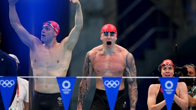 James Guy, Adam Peaty and Kathleen Dawson celebrate after winning the gold